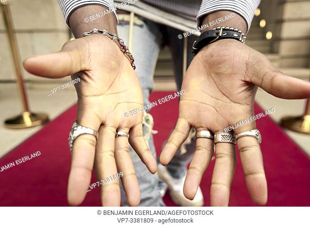 palms of famous celebrity on red carpet
