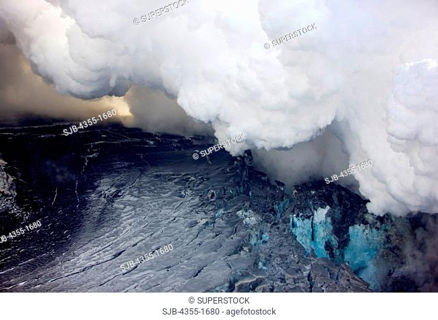 Steaming craters during the Eyjafjallajokull volcanic eruption on Mt. Eyjafjoll in Iceland. Lava broke through the Gigjokull Glacier, mixed with water