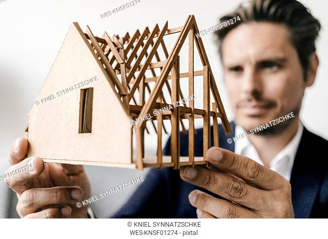 Close-up of architect examining architectural model