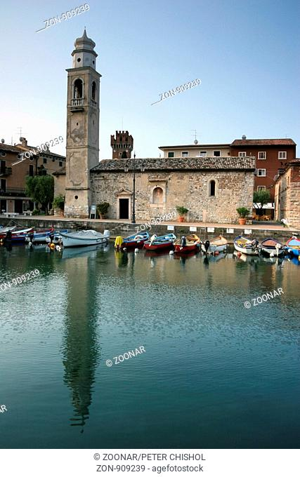 Early morning by the harbour in Lazise with the San Nicolò Church
