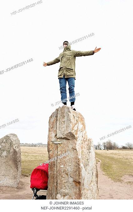 Man standing on top of rock