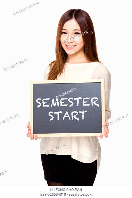 Woman hold with chalkboard showing phrases of semester start