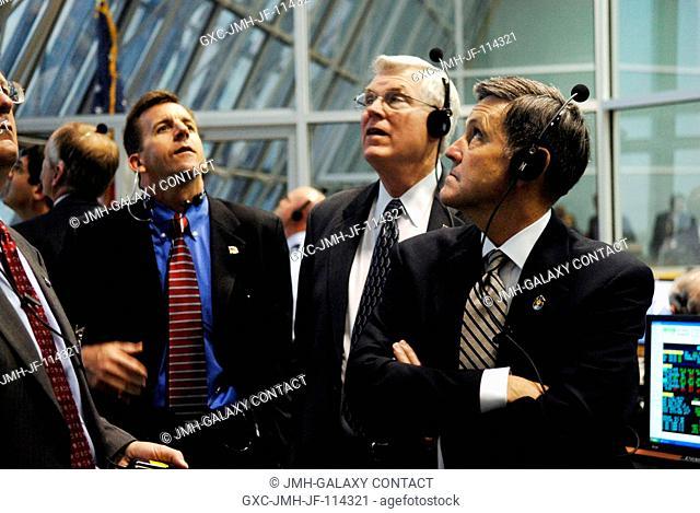 From left, LeRoy Cain, NASA's deputy manager, Space Shuttle Program; Michael Coats, director of NASA's Johnson Space Center; and Bob Cabana