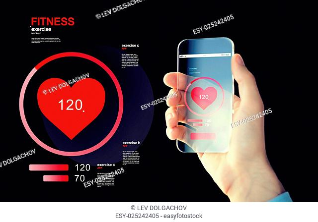 technology, health care, application and people concept - close up of male hand holding and showing transparent smartphone with red heart icon on screen and...
