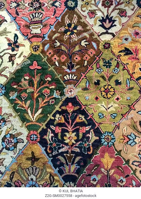 A beautiful oriental design, consisting of diamonds and triangles, with vines and flowers, in a handmade rug, Canada