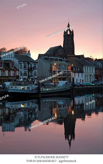 Boats moored in town harbour at sunset, Tarbert, Kintyre Peninsula, Loch Fyne, Argyll and Bute, Scotland, october