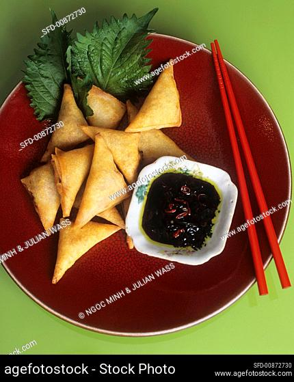 Fried pastries (spring roll style) and chilli sauce
