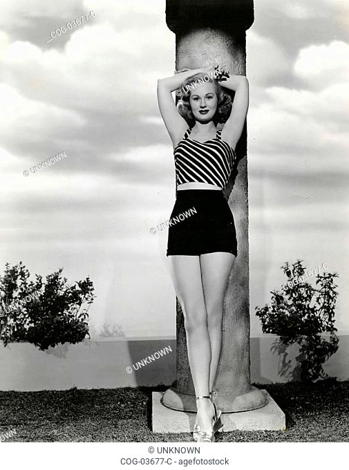 The American actress Virginia Mayo in shorts and T-shirt with stripes
