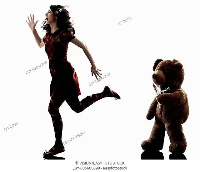 one caucasian strange young woman killer teddy bear in silhouette white background