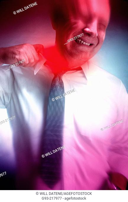 Businessman pulling collar showing stress
