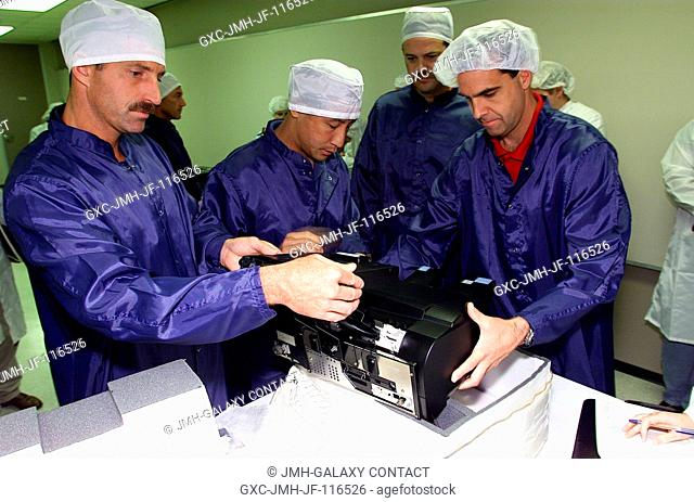 Four members of the STS-106 crew participate in a bench review of equipment and gear scheduled to fly in the September mission aboard the Space Shuttle Atlantis