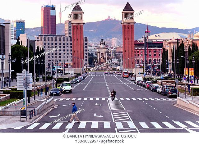 Reina Maria Cristina Avenue, at the ens Twin Venetian towers and Plaça d'Espanya - Plaza Espana with monumental fountain by Josep Maria Jujol in center