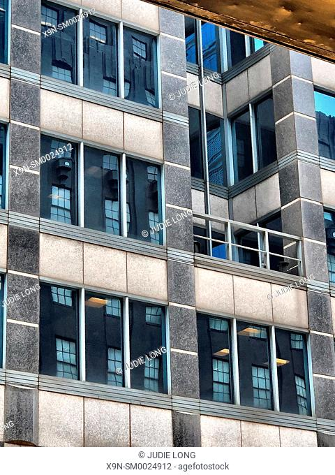 New York City, Manhattan . Looking up at Window and Trim Patterns on a Manhattan, New Youk City, Office Building