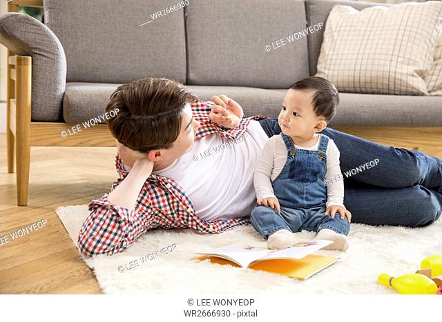 Loving father playing with his baby