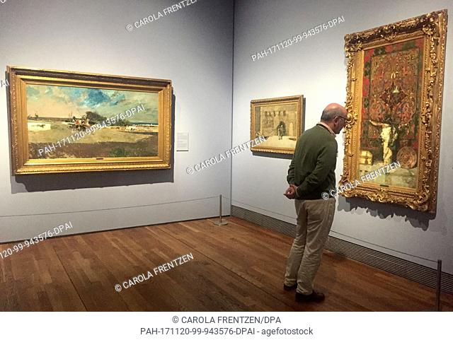"A visitor regards the painting """"Arab Leaning against a Tapestry"""" (1873) by the painter Maria Fortuny, photographed at the Prado Museum in Madrid, Spain"