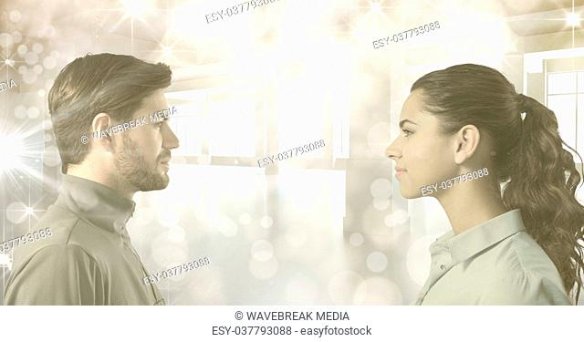 Man and woman looking at each other in bright room