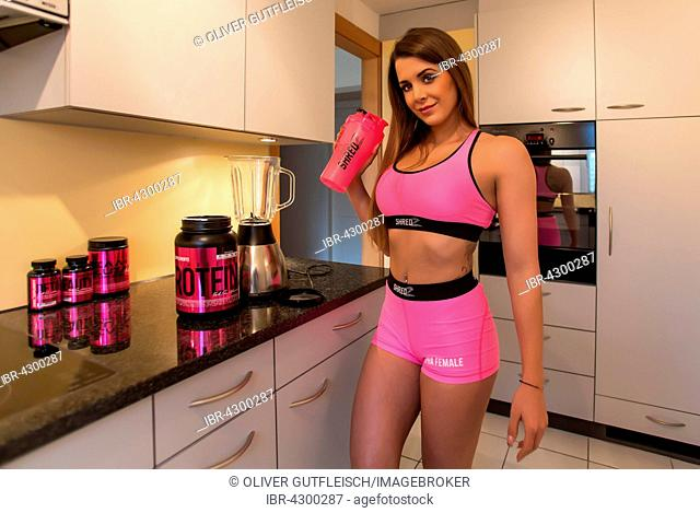 Young woman with fitness drink