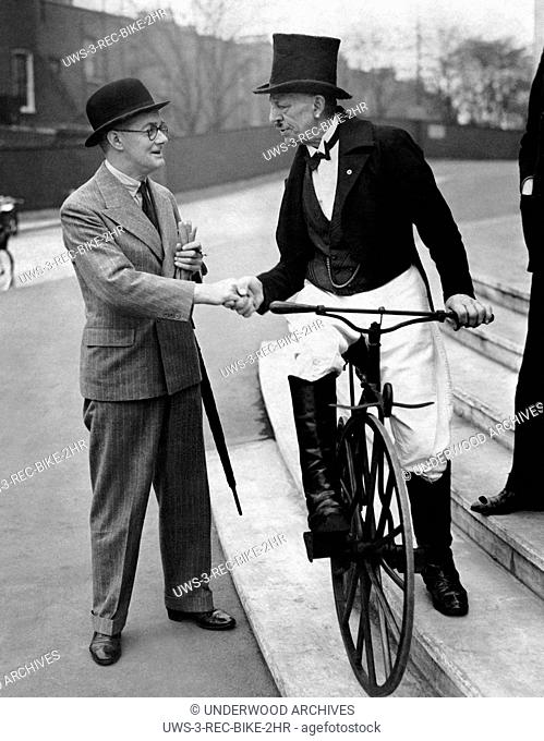London, England: July 11, 1938. Lord Nuffield greets Arthur J. Dick who rode his 70 year cycle to Earl's Court for the opening of the Cycle & Motor Cycle Show