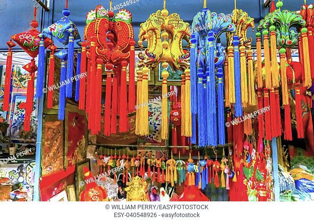 Blue Red Yellow Chinese New Year Silk Decorations Panjuan Flea Market Decorations Beijing China. Panjuan Flea Curio market has many fakes