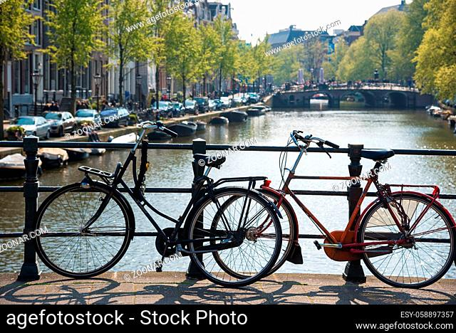 Bikes on the bridge in Amsterdam. Canals of Amsterdam, Netherland