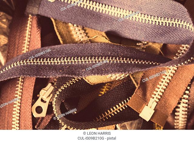 Close-up of pile of zips, in leather jacket manufacturers