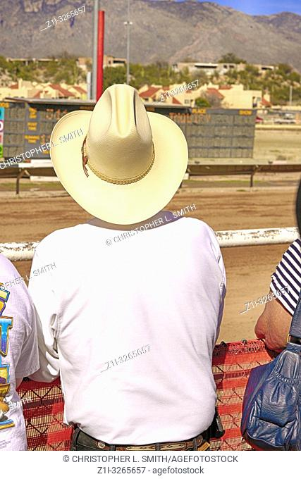 Man wearing a stetson hat at the Rillito Park horse racing track in Tucson, AZ