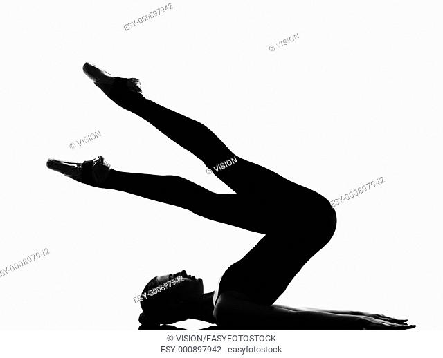 beautiful caucasian tall woman ballet dancer halasana Shoulder Stand yoga pose full length on studio isolated white background