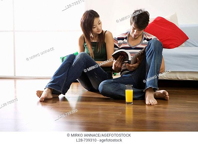 young couple reading book