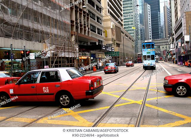 Streetscene with taxis and the tram, Central, Hong Kong, China, East Asia