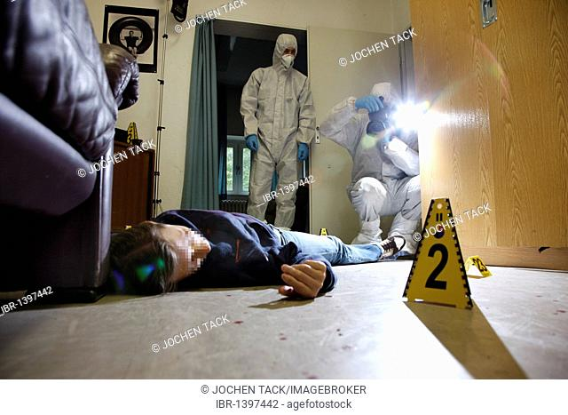 Photographic securing of forensic evidence, officers of the C.I.D., the Criminal Investigation Department, gathering forensic evidence at a crime scene