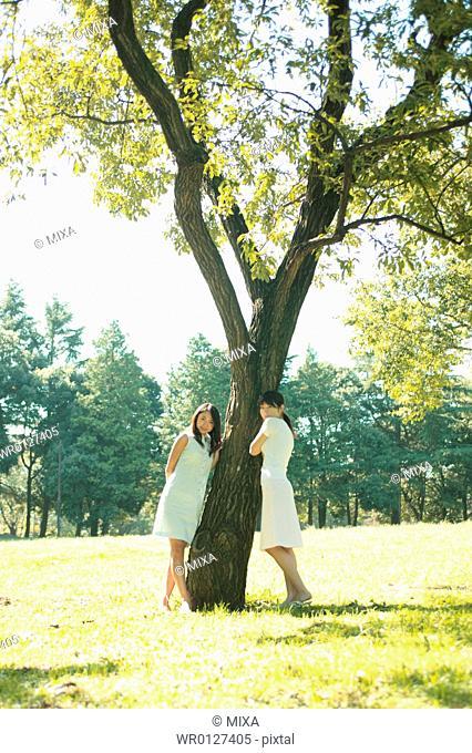 Two women standing in park