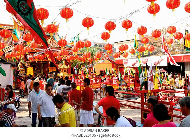 Thailand Phuket Phuket Town People queue to enter the Hock Nguan Kong Shrine at Chinese New Year