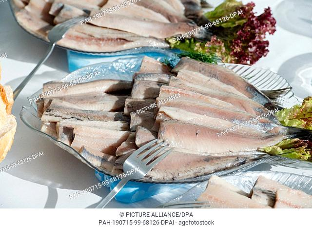 08 July 2019, Mecklenburg-Western Pomerania, Sassnitz: Herring snacks stand on a table in the EuroBaltic fish factory of the Dutch Parlevliet & Van der Plas...