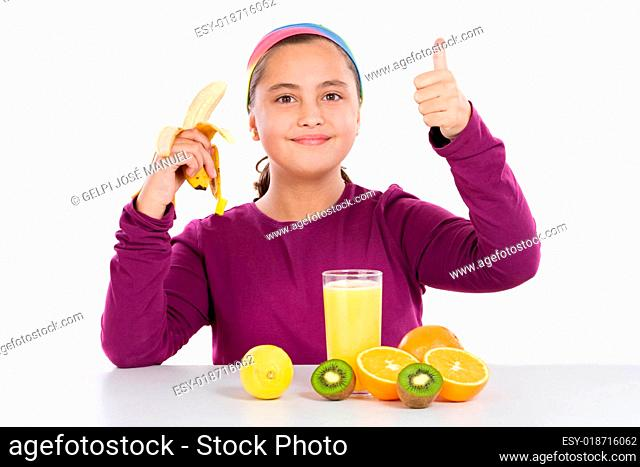 Cute girl with many fruits