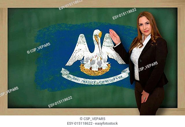 Successful, beautiful and confident woman showing flag of louisiana on blackboard for marketing research, presentation and tourist advertising