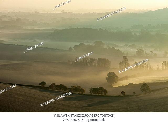 Misty autumn sunrise in South Downs National Park near Alfriston, East Sussex, England