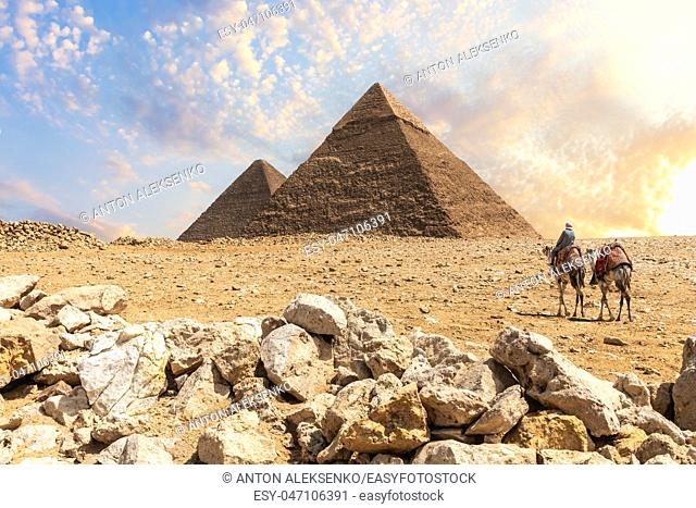 The Great Pyramids in the desert of Giza with the bedouins nearby, Cairo, Egypt