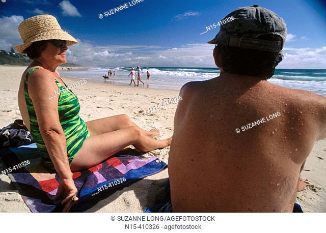 Middle-aged couple on the beach, Sunshine Beach, near Noosa, Sunshine Coast, Queensland, Australia