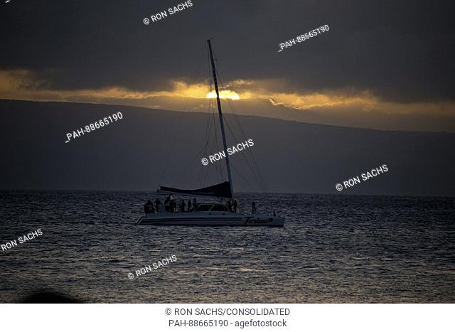 Whale watching boat at sunset from Kaanapali Beach in Lahaina, Maui, Hawaii on Monday, February 20, 2017. Kaanapali Beach is the home of several hotels and time...