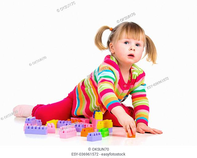 kid girl playing with toys. Isolated on white background