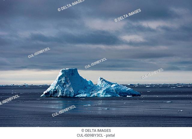 Arctic ocean ice floe and iceberg, Erik Eriksenstretet strait separating Kong Karls Land from Nordaustlandet, Svalbard, Norway