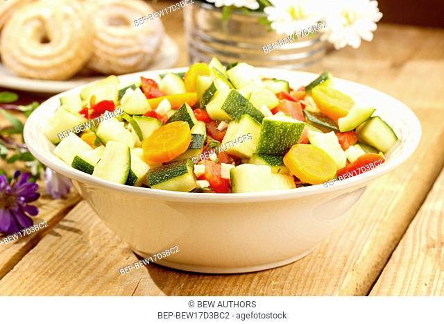 Fresh vegetable salad in white bowl