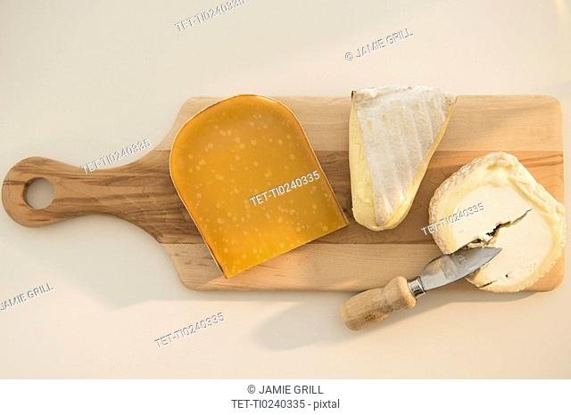 Studio shot of cheese on chopping board