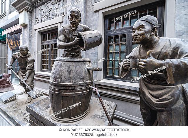 Bronze sculptures in front of restaurant in Qianmen area in Beijing, China