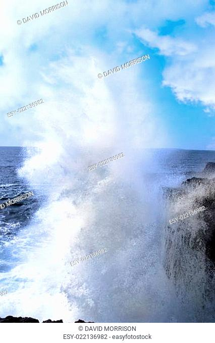 giant wave crashing on cliffs