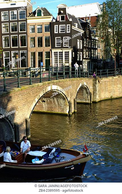 Dutch houses and bridge over Amstel River, Amsterdam, Netherlands, Europe