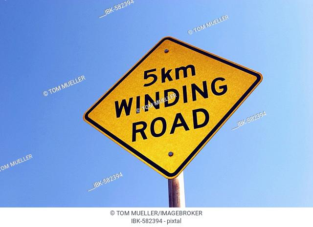 Sign winding road