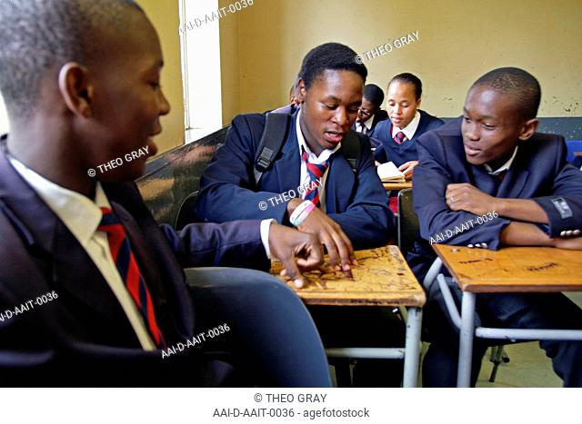School children reading in classroom, St Mark's School, Mbabane, Hhohho, Kingdom of Swaziland
