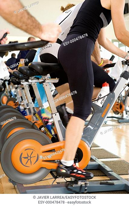 Spinning, training program for cardiovascular work and toning up in exercise bicycle