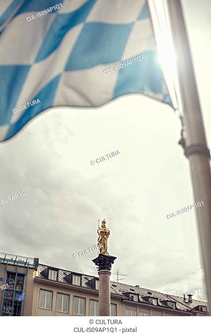 Bavarian flag in Marienplatz with Virgin Mary Statue, Munich, Germany